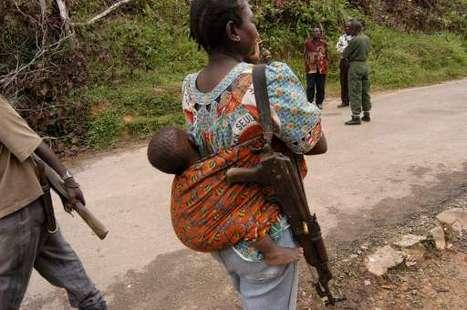 TIRED OF BEING GANG RAPED, CONGO MOTHER TAKES UPWEAPON