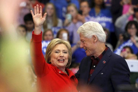 U.S. Democratic presidential candidate Hillary Clinton waves after being introduced by Bill Clinton during a campaign rally in Cedar Rapids, Iowa